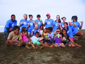 Costa Rica teen sea turtle campers performing community service.